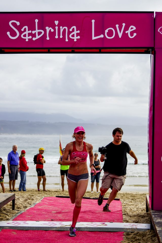 Road runners, open-water swimmers and surfski paddlers compete in the 2014 Sabrina Love Ocean Challenge, presented by Discovery and Stonehage, and organised by Magnetic South, held in Plettenberg Bay, Western Cape, South Africa, RSA